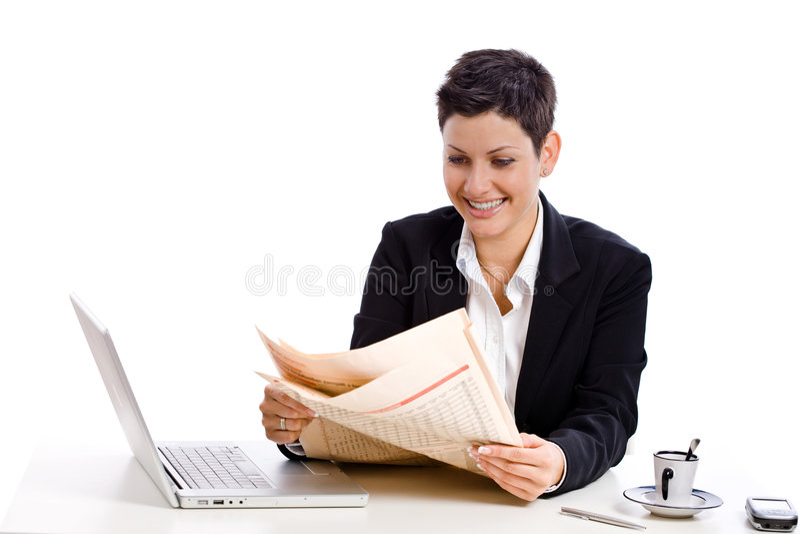 Businesswoman reading newspaper stock photos