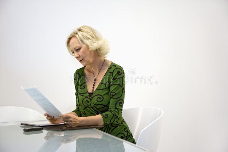 Download Businesswoman Reading Paperwork Stock Image - Image of office, professional: 4996867