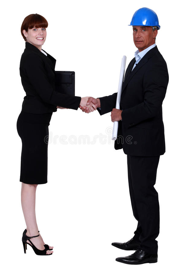 Businesswoman and real estate agent stock images