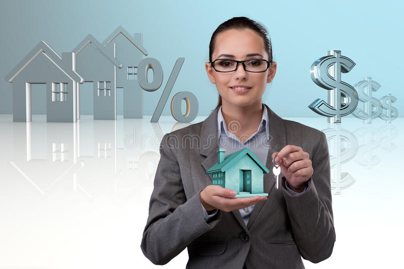 The businesswoman in real estate mortgage concept. Businesswoman in real estate mortgage concept stock photography