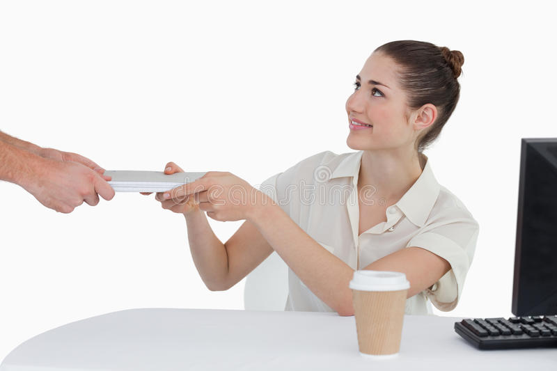 Businesswoman receiving documents stock photography
