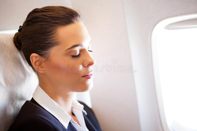 Businesswoman resting on airplane royalty free stock images