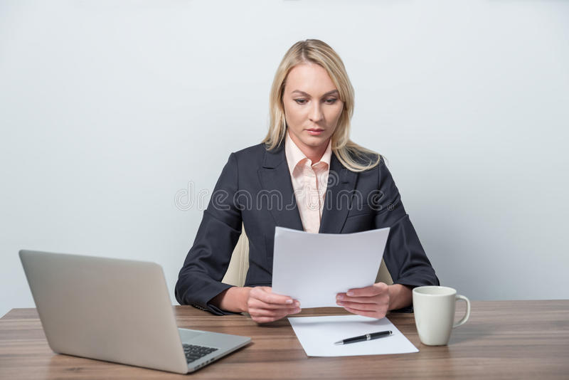 Businesswoman is reviewing legal documents. royalty free stock image