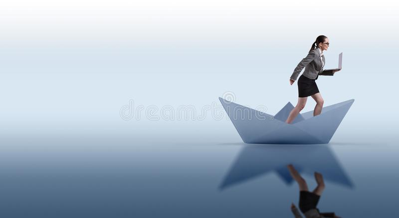 The businesswoman riding paper boat ship in business concept royalty free stock images