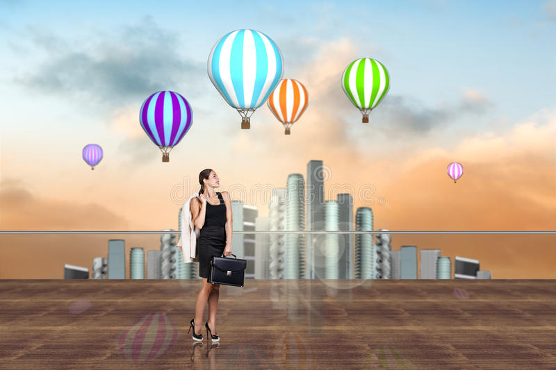 Businesswoman on the roof royalty free stock photography