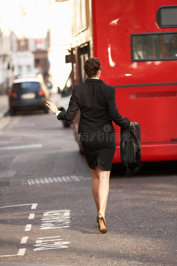 Businesswoman running for bus royalty free stock images