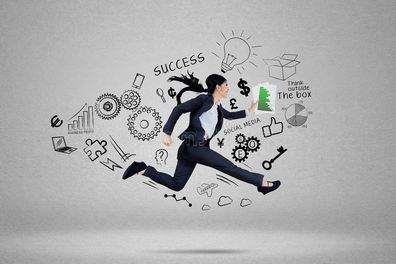 Businesswoman running for chasing her target royalty free stock images
