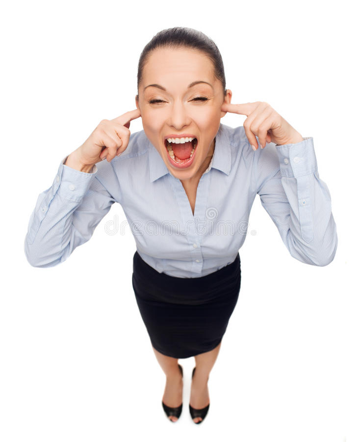 Businesswoman screaming with closed ears royalty free stock images