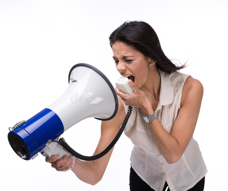 Businesswoman screaming at herself with megaphone royalty free stock images