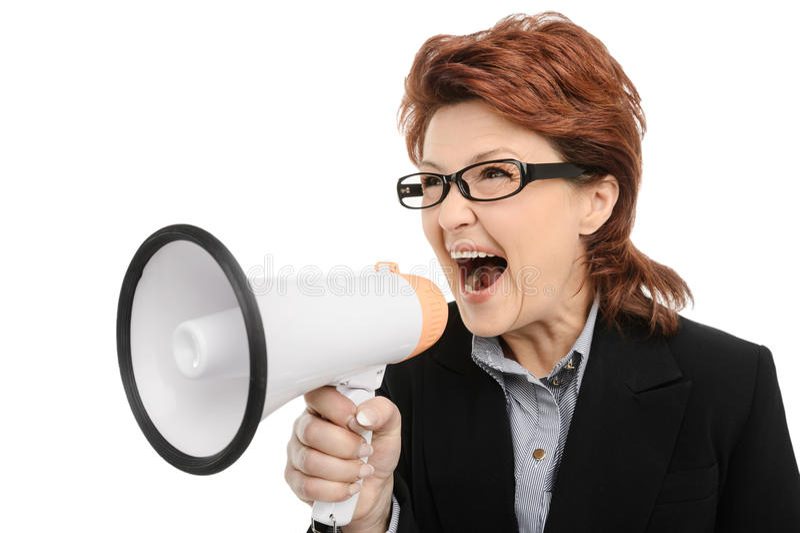 Businesswoman screaming through megaphone royalty free stock image