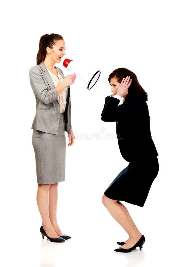 Businesswoman screaming in megaphone. stock photo