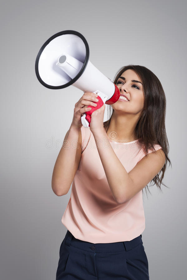 Businesswoman screaming by megaphone royalty free stock photos