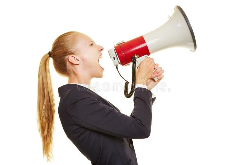 Businesswoman screaming into megaphone stock photos