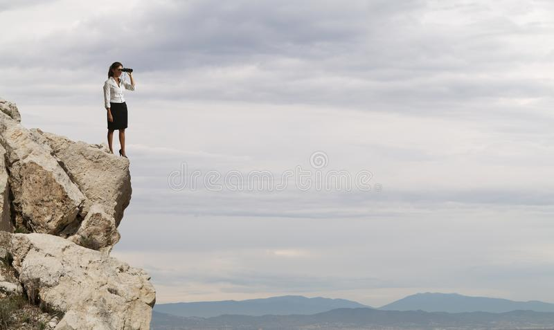Businesswoman searchs for new horizon, new business opportunities royalty free stock photos