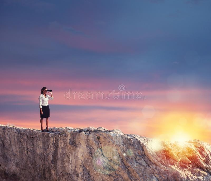 Businesswoman searchs for new horizon, new business opportunities stock photography