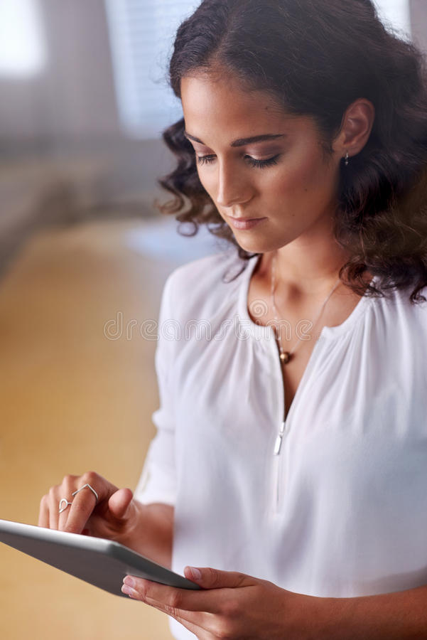 Businesswoman sending email tablet stock images