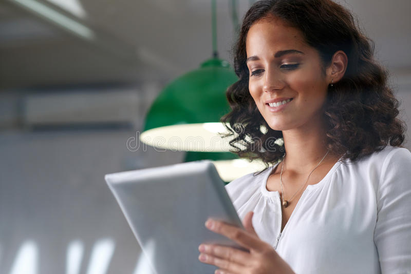 Businesswoman sending email tablet royalty free stock photography