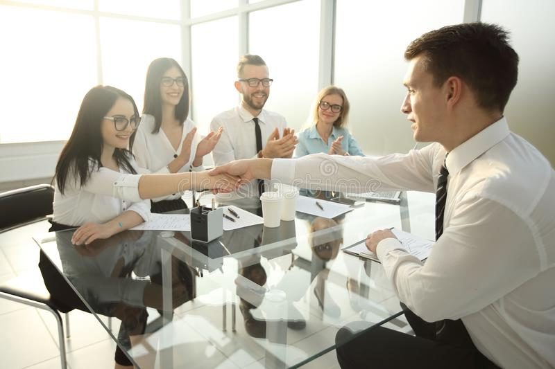 Businesswoman shaking hands with a new employee stock photos
