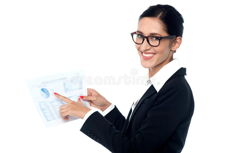 Businesswoman sharing annual reports. Female executive holding corporate documents royalty free stock photo