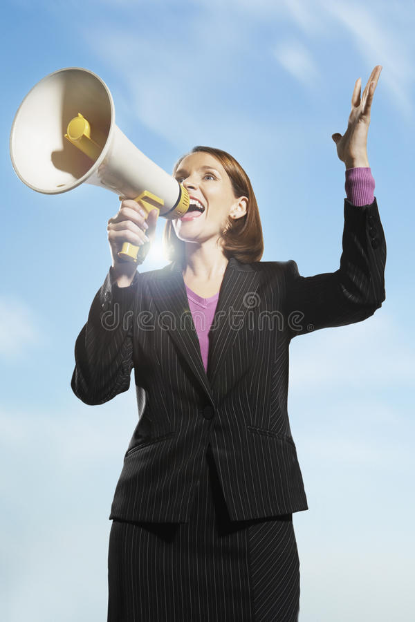 Download Businesswoman Shouting Through Megaphone Stock Photo - Image of female, loudspeaker: 31841956