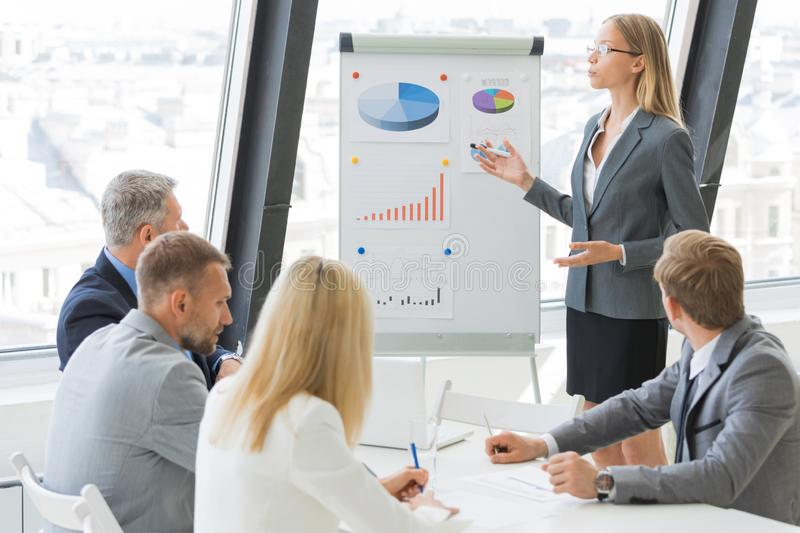 Business woman show graph. Businesswoman show graph at flichart to business people group on presentation at conference meeting stock photos