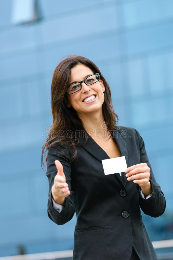 Businesswoman showing business card and offering handshake stock images