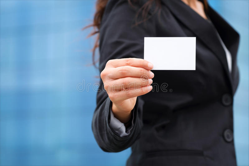 Businesswoman showing business card royalty free stock photo