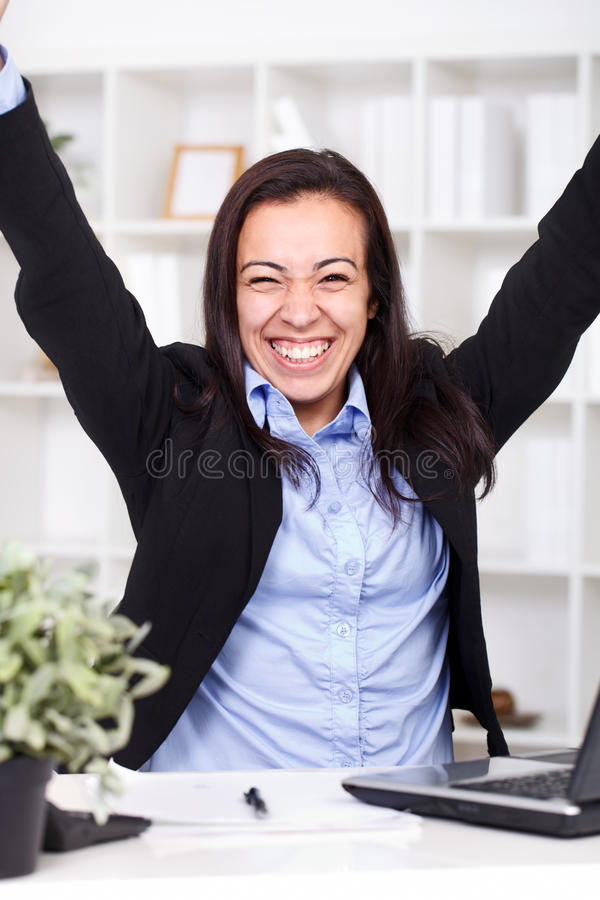 Businesswoman showing her victory stock photography