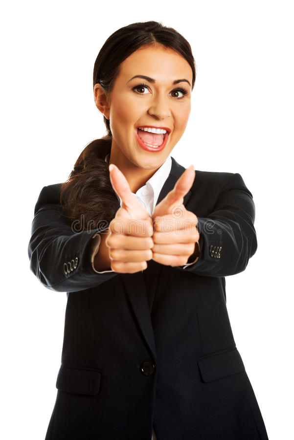 Businesswoman showing ok sign. Businesswoman with thumbs up gesture stock photography