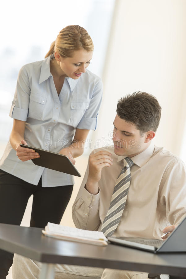 Download Businesswoman Showing Plan To Colleague On Digital Tablet In Off Stock Photo - Image of desk, looking: 32429872