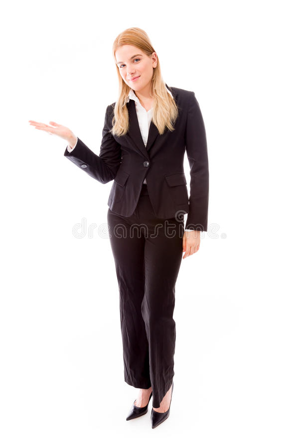 Businesswoman showing product with open hand palm. Young adult caucasian woman isolated on a white background stock image