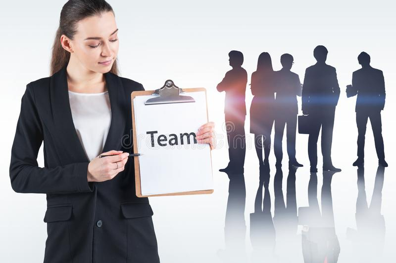 Businesswoman showing word team stock photo
