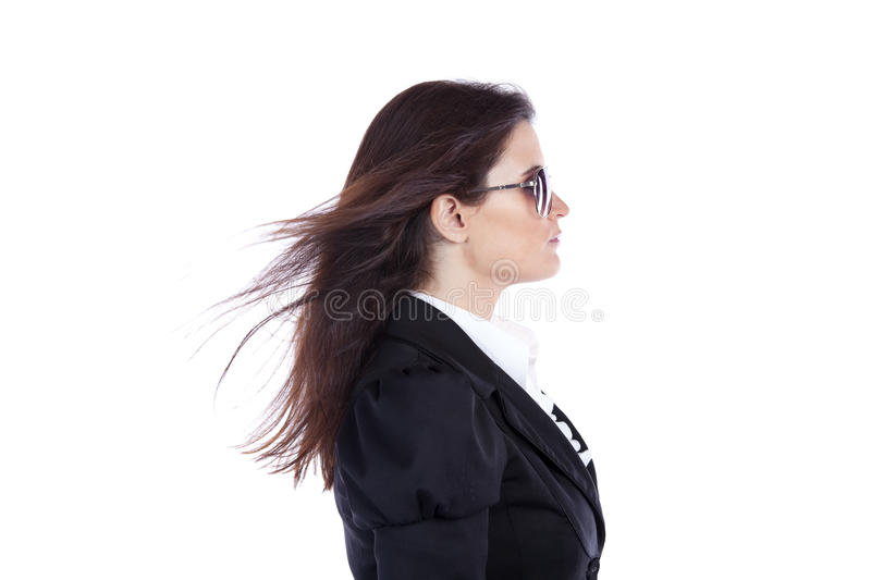 Businesswoman side view. With wind over her hair stock images