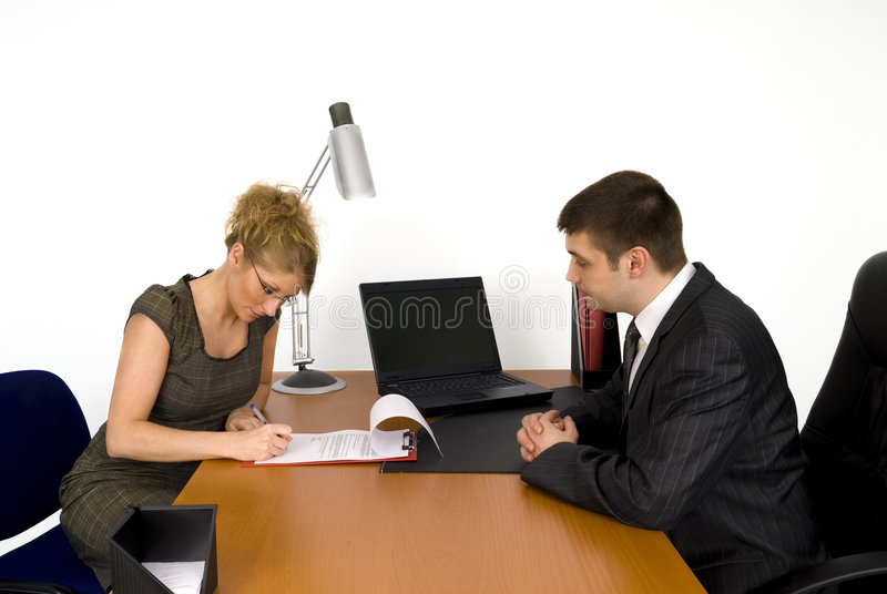 Businesswoman signing the contract. stock photos