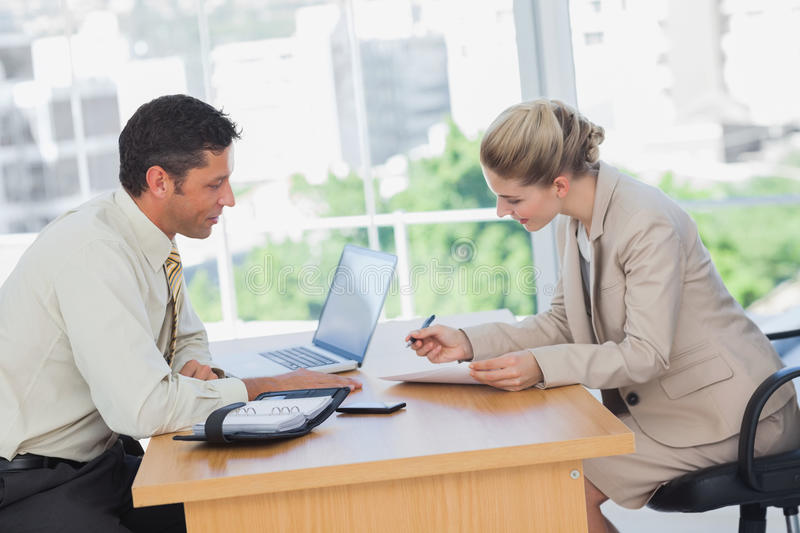 Businesswoman signing contract at interview stock photo