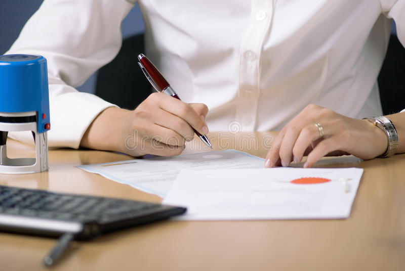 Businesswoman signing document stock photos