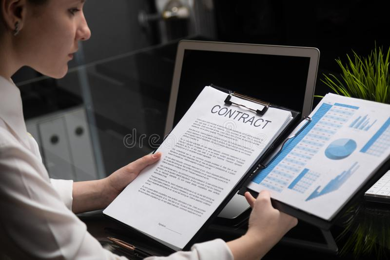 Young girl holding a contract and firm statistics stock image