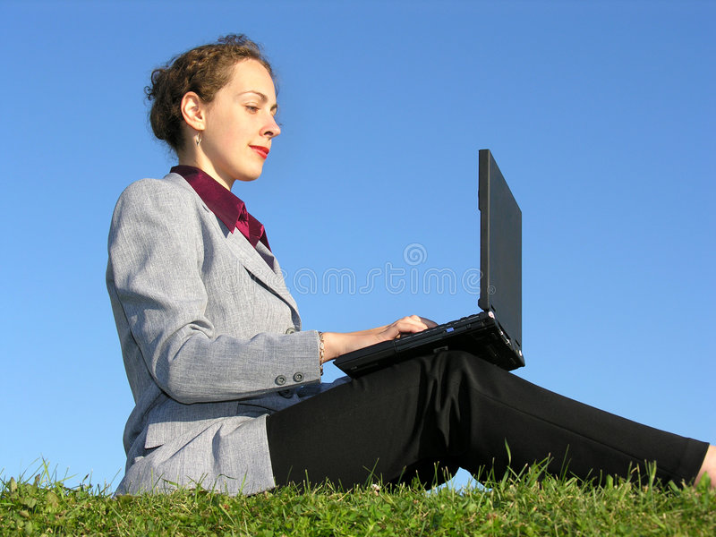 Businesswoman Sit With Notebook On Blue Sky 2 Royalty Free Stock Photography