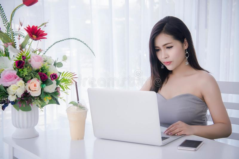 Businesswoman sit and working in notebook , beautyful girl work royalty free stock image