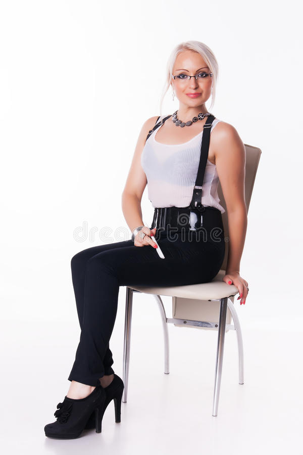 Businesswoman sits on a chair. With the handle at the white background royalty free stock photo