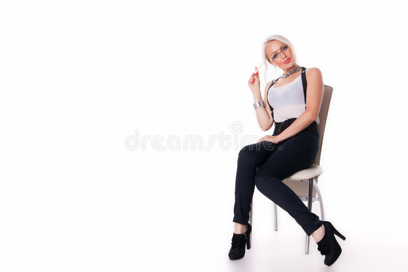 Businesswoman sits on a chair. With the handle at the white background stock photos