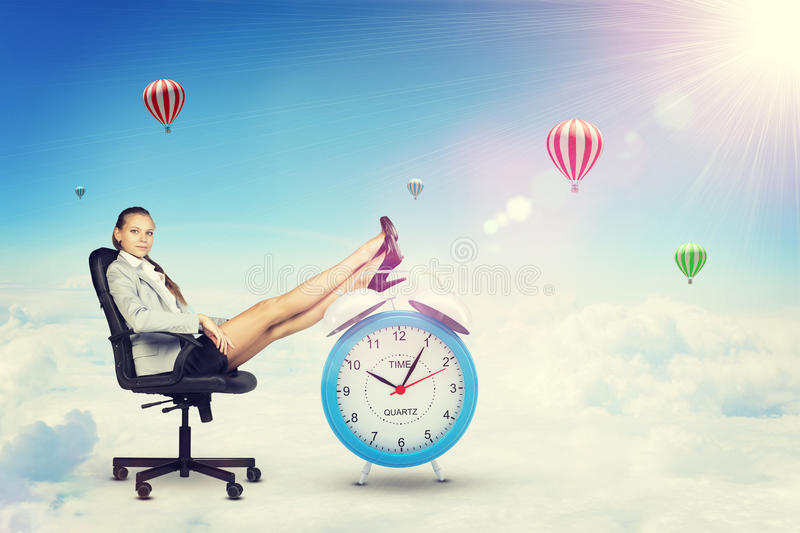 Businesswoman sits in chair. Put your feet up on stock illustration