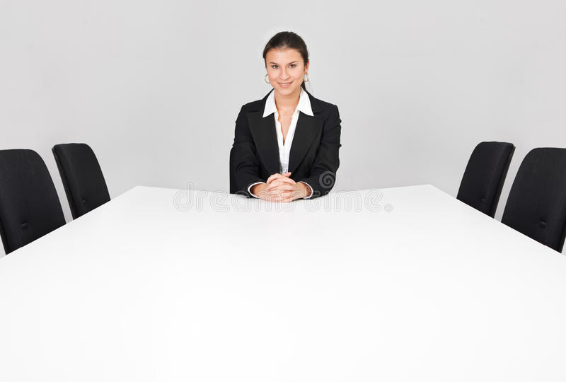 Businesswoman sitting alone royalty free stock photography