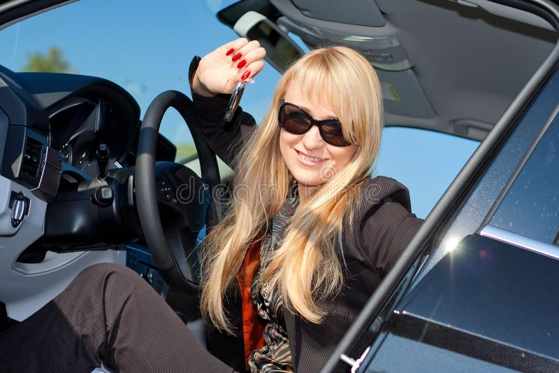 Businesswoman sitting in a car stock photo