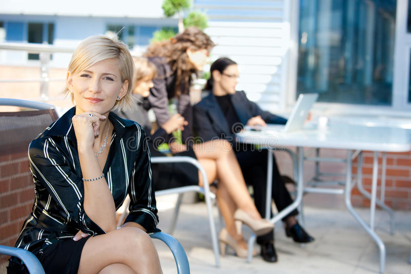 Businesswoman sitting in chair royalty free stock images