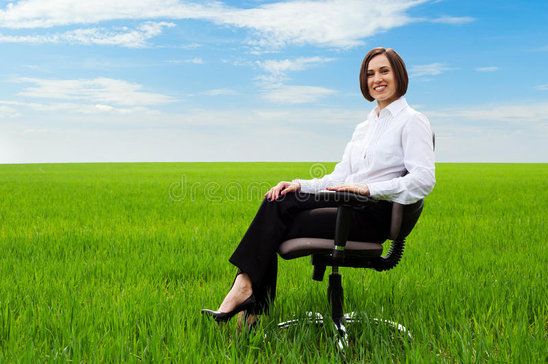 Businesswoman Sitting On Chair Stock Photo