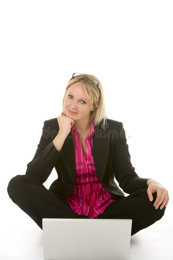 Businesswoman Sitting In Front Of Laptop Thinking Royalty Free Stock Images
