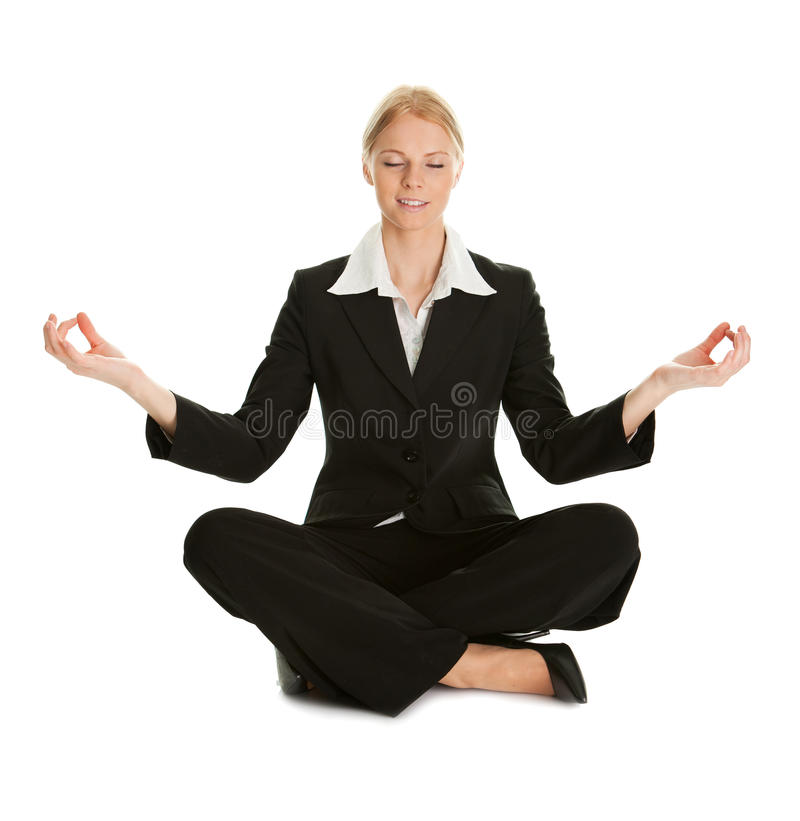 Businesswoman sitting in lotus flower position. Of yoga. Isolated on white royalty free stock image