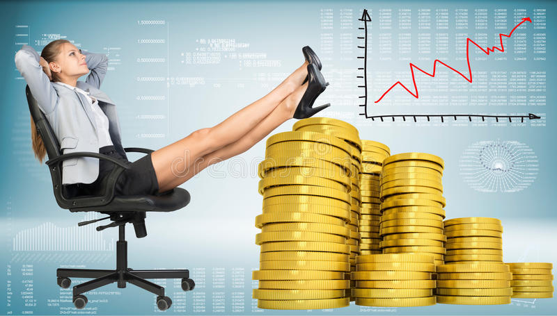 Businesswoman sitting on office chair with golden stock image