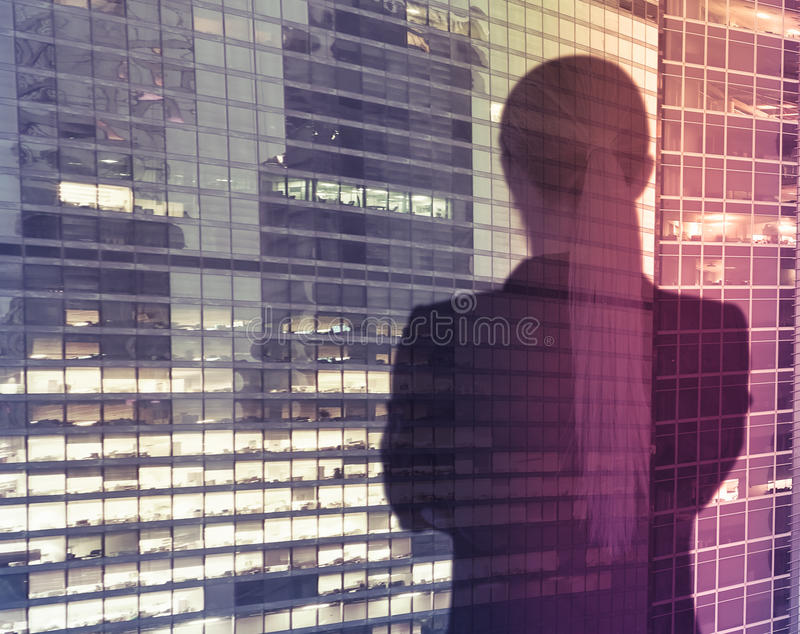 Businesswoman on skyscraper background stock photography